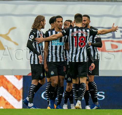1st November 2020; St James Park, Newcastle, Tyne and Wear, England; English Premier League Football, Newcastle United versus Everton; Callum Wilson of Newcastle United celebrates scoring his second goal with team mates in minute 84 to take Newcastle 2-0 up against Everton