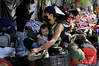 MEDELLÍN, COLOMBIA, MAY 14: Venezuelan migrant want to return to their country, they wait outside the bus terminal in Medellín, Colombia, on May 14, 2020. Migrants hope to have the opportunity to take a bus to the border because to the new pandemic. . from COVID19. (Photo by Fredy Builes / VIEWpress via Getty Images)