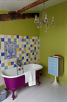 Florence Jaffrain transformed a former metalworks in Paris into a live/work space for herself, incorporating a mixture of bright colours to make rooms, such as this bathroom, more cosy