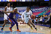 GREENSBORO, NC - MARCH 6: Marnelle Garraud #14 of Boston College drives past Shania Meertens #31 of Clemson University during a game between Clemson and Boston College at Greensboro Coliseum on March 6, 2020 in Greensboro, North Carolina.