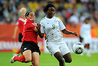 Rhian Wilkinson (l) of team Canada and Ebere Orji of team Nigeria during the FIFA Women's World Cup at the FIFA Stadium in Dresden, Germany on July 5th, 2011.