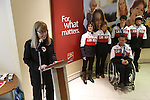 Ottawa, ON - March 28 2014- Canadian Paralympic Committee CEO Karen O'Neill speaks at the CIBC Paralympic Welcome Home Event at CIBC South Keys Banking Centre in Ottawa as Ottawa's five Sochi Paralympians look on (Photo: Patrick Doyle/CIBC)