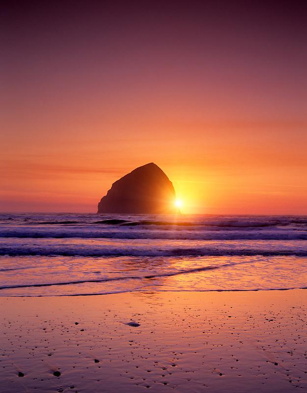 Sunset at Cape Kiwanda beach with Haystack Rock, Oregon.