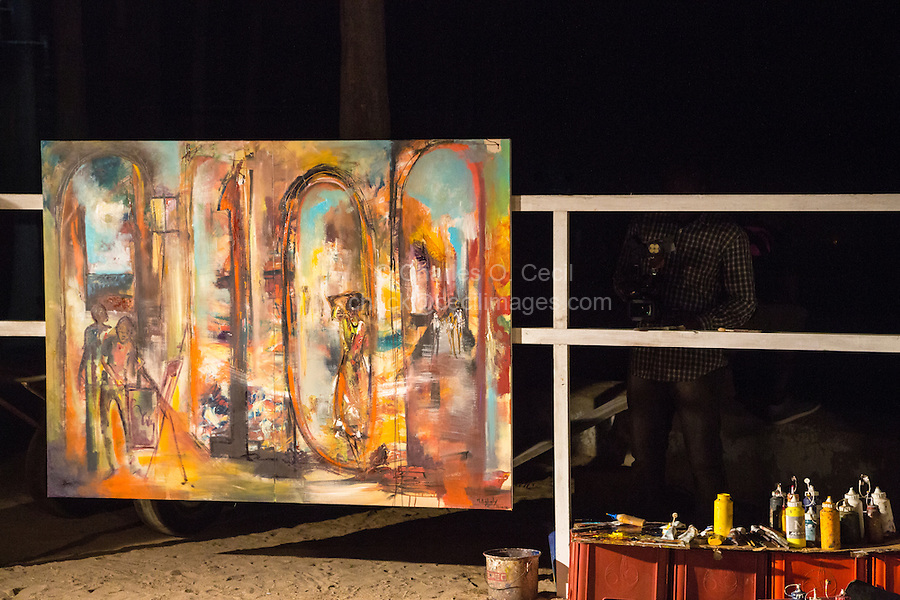 Painter Paints a Canvas During Dinner to Commemorate 10th Anniversary of Biannual Arts Festival on Goree Island, Senegal.  Completed Canvas in One Hour 15 minutes.