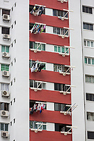 Singapore Apartment Building with Laundry Hanging out to Dry.