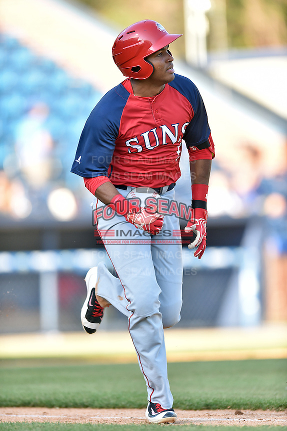 Hagerstown Suns third baseman Kelvin Gutierrez (5) runs to first during a game against the Asheville Tourists at McCormick Field on April 28, 2016 in Asheville, North Carolina. The Tourists were leading the Suns 6-5 when the game was delayed in the top of the 6th inning due to darkness. (Tony Farlow/Four Seam Images)