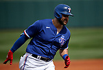 Joey Gallo rounds third after hitting a home run during a spring training game between the Texas Rangers and Los Angeles Dodgers in Surprise, Ariz., on Sunday, March 7, 2021.<br /> Photo by Cathleen Allison