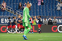 FOXBOROUGH, MA - MAY 16: Eloy Room #1 Columbus SC reacts to the New England Revolution goal as New England celebrate in the background during a game between Columbus SC and New England Revolution at Gillette Stadium on May 16, 2021 in Foxborough, Massachusetts.