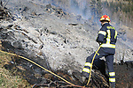 Countryside's Fire in Val de Mocheni. Frassilongo, Italy on March 24, 2021. Firefighters in action to put out the fire helped by an helicopter.