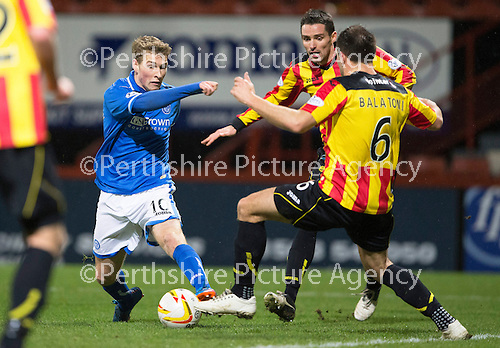 Partick Thistle v St Johnstone....21.01.14   SPFL<br /> David Wotherspoon forces his way into the box past Conrad Balatoni and Lee Mair to set up Stevie May's goal<br /> Picture by Graeme Hart.<br /> Copyright Perthshire Picture Agency<br /> Tel: 01738 623350  Mobile: 07990 594431