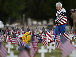 Peggy Truttman walks through the veteran's section of the cemetary before the annual Memorial Day Ceremony at Lone Mountain Cemetery in Carson City, Nev., on Monday, May 27, 2013. .Photo by Cathleen Allison