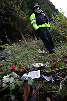 Pictured: Floral tributes left by a South Wales Police officer at the scene where the body of Rebecca Aylward was discovered. Monday 25 October 2010<br /> Re: 15 year old Rebecca Aylward has been found murdered in woodlands near Aberkenfig south Wales. Two fifteen year old men have been arrested. Aylward was originally from nearby Maesteg.