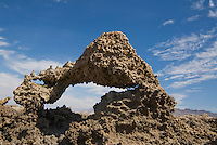 Salt and mud are shaped into an arch by wind and rain at the Devil's Golf Course, Death Valley National Park, California.
