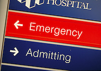 Hospital Sign, close-up of words, ' Emergency' , ' Admitting'.