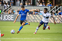 SAN JOSE, CA - AUGUST 13: Cristian Espinoza #10 of the San Jose Earthquakes dribbles the ball past Javain Brown #23 of the Vancouver Whitecaps during a game between San Jose Earthquakes and Vancouver Whitecaps at PayPal Park on August 13, 2021 in San Jose, California.