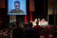 """Rosa Luxemburg-Konferenz 2016 am Samstag den 9. Januar 2016.<br /> Ueber 2500 Menschen sollen nach Angaben des Veranstalters, der Tagenszeitung """"junge Welt"""", zur 21 Rosa Luxemburg-Konferenz gekommen sein. Linke Verlage und Organisationen praesentierten sich den Konferenzbesuchern.<br /> Im Bild: Ein Live-Interview mit Alexej Markov, Gruender und Kommandeur der politischen Abteilung der kommunistischen Brigade """"Prisrak"""" in der Ostukraine.<br /> 9.1.2016, Berlin<br /> Copyright: Christian-Ditsch.de<br /> [Inhaltsveraendernde Manipulation des Fotos nur nach ausdruecklicher Genehmigung des Fotografen. Vereinbarungen ueber Abtretung von Persoenlichkeitsrechten/Model Release der abgebildeten Person/Personen liegen nicht vor. NO MODEL RELEASE! Nur fuer Redaktionelle Zwecke. Don't publish without copyright Christian-Ditsch.de, Veroeffentlichung nur mit Fotografennennung, sowie gegen Honorar, MwSt. und Beleg. Konto: I N G - D i B a, IBAN DE58500105175400192269, BIC INGDDEFFXXX, Kontakt: post@christian-ditsch.de<br /> Bei der Bearbeitung der Dateiinformationen darf die Urheberkennzeichnung in den EXIF- und  IPTC-Daten nicht entfernt werden, diese sind in digitalen Medien nach §95c UrhG rechtlich geschuetzt. Der Urhebervermerk wird gemaess §13 UrhG verlangt.]"""