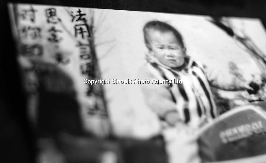 """Picture of a little girl, Lin Yun, 3 years old, lost in GuanDu district in Kumming city on 11 June 2004. Message read """"Our endless missing of you is beyond words.""""..PHOTO BY SINOPIX"""
