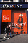 Sex shops UK 2000s. Older couple walking past the front of a Harmony sex shop, the frontage is discreet. Soho London