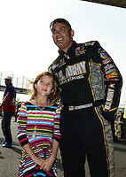 Sept. 30, 2012; Madison, IL, USA: NHRA top fuel dragster driver Tony Schumacher with his daughter during the Midwest Nationals at Gateway Motorsports Park. Mandatory Credit: Mark J. Rebilas-