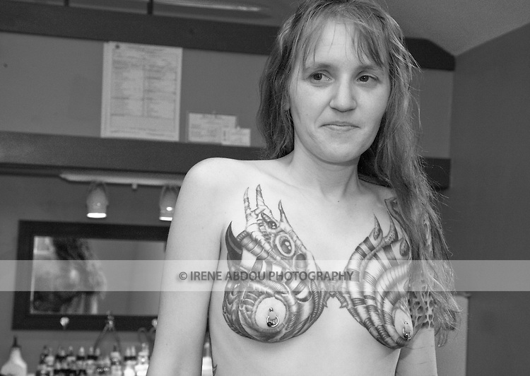 The wife of a body piercer displays her many tattoos and piercings at a tattoo parlor in Rockland, Maine.<br /> <br /> This image may not be licensed for any pornographic or defamatory use.