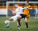 Ayr Utd's David Sinclair  and Alloa's Darren Young challenge for the ball.