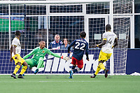 FOXBOROUGH, MA - MAY 16: Eloy Room #1 Columbus SC leaps for a shot on goal that was overruled by the official during a game between Columbus SC and New England Revolution at Gillette Stadium on May 16, 2021 in Foxborough, Massachusetts.
