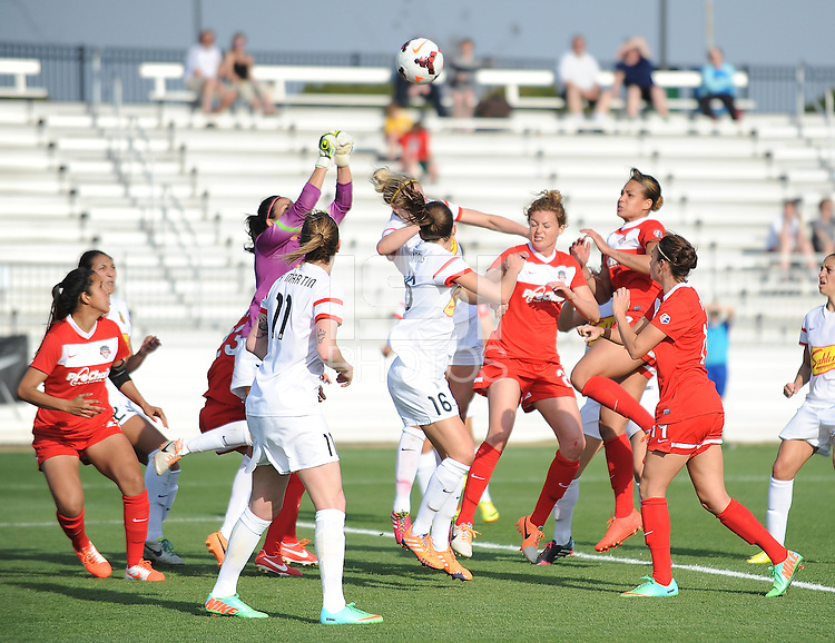 Boyds MD - April 13, 2014: Lydia Williams (1) of the Western New York Flash goes up to make a save. The Western New York Flash defeated the Washington Spirit 3-1 in the opening game of the 2014 season of the National Women's Soccer League at the Maryland SoccerPlex.