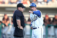 Rancho Cucamonga Quakes manager Juan Bustabad #14 argues a call with umpire Alberto Ruiz during a game against the Modesto Nuts at The Epicenter on July 16, 2011 in Rancho Cucamonga,California. Rancho Cucamonga defeated Modesto 7-3.(Larry Goren/Four Seam Images)