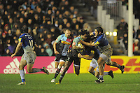 Marland Yarde of Harlequins is tackled by Billy Vunipola of Saracens during the Premiership Rugby match between Harlequins and Saracens - 09/01/2016 - Twickenham Stoop, London<br /> Mandatory Credit: Rob Munro/Stewart Communications