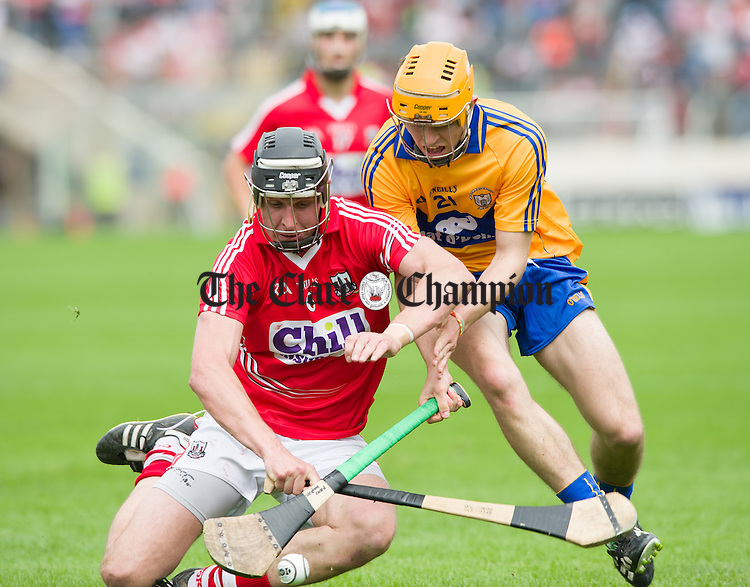 Tadhg Healy of Cork in action against Stephen Ward of Clare during their Intermediate hurling game at Thurles. Photograph by John Kelly.