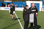 Lancaster City 0 FC Halifax Town 3, 15/10/2011, Giant Axe, FA Cup Third Qualifying Round. A league official making a 'fair play' presentation to a member of backroom staff at Lancaster City's Giant Axe ground prior to the club's FA Cup third qualifying round match against FC Halifax Town. The visitors, who play two leagues above their hosts in the English football pyramid, won the ties by three goals to nil, watched by a crowd of 646 spectators. Lancaster City were celebrating their centenary in 2011, although there was a dispute over the exact founding date over the club known as Dolly Blue. Photo by Colin McPherson.