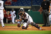 Maryland Terrapins catcher Justin Morris (10) fields a throw during a game against the Louisville Cardinals on February 18, 2017 at Spectrum Field in Clearwater, Florida.  Louisville defeated Maryland 10-7.  (Mike Janes/Four Seam Images)