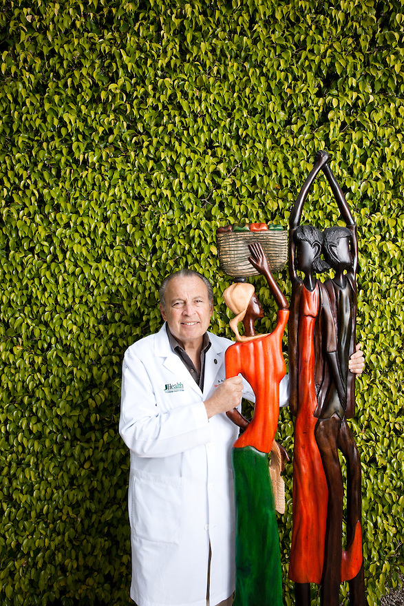 Dr. Barth Green, founder of Project Medishare, photographed at his Miami home with several of his Haitian sculptures