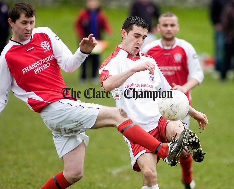 Newmarkets Michael McCoy and Corofins Ryan Haran battle for possession at Corofin.Pic Arthur Ellis.