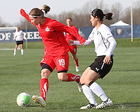 Rebecca Moros #19 of the Washington Freedom moves the ball away from Karina Maruyama #11 of the Philadelphia Independence during a WPS pre season match at the Maryland Soccerplex on March 27 2010 in Boyds, Maryland. The game ended in a 0-0 tie.