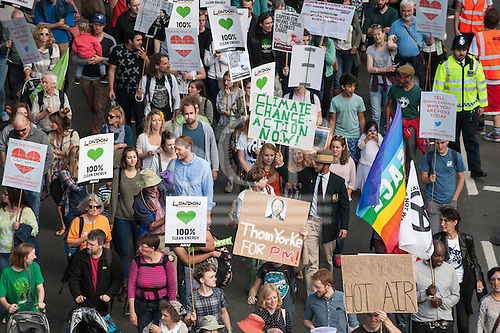 Marchers hold placards aloft, some printed and some hand-made, at the Climate Change demonstration, London, 21st September 2014. © Sue Cunningham