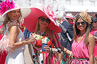 30th April 2021; Kentucky, USA;  Spectators pose for a photo with their hats on during Oaks Day on April 30, 2021 at Churchill Downs in Louisville, Kentucky.