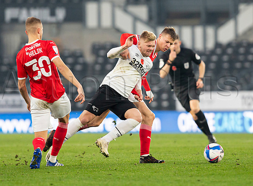 7th November 2020; Pride Park, Derby, East Midlands; English Football League Championship Football, Derby County versus Barnsley; Kamil Jozwiak of Derby County holds off Mads Anderson of Barnsley for the ball