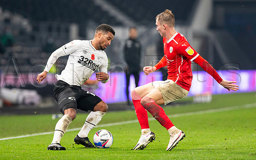 7th November 2020; Pride Park, Derby, East Midlands; English Football League Championship Football, Derby County versus Barnsley; Nathan Byrne of Derby County turns quickly on the ball as Cauley Woodrow of Barnsley comes in to tackle