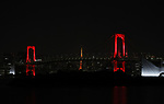 """June 2, 2020, Tokyo, Japan - The Rainbow Bridgel is lit up in red color after changing from rainbow colors for the """"Tokyo alert"""" in Tokyo on Tuesday, June 2, 2020. Tokyo Metropolitan government confirmed 34 people became infected with the new coronavirus on the day and Governor Yuriko Koike warned the """"Tokyo alert"""" for Tokyo residents.     (Photo by Yoshio Tsunoda/AFLO)"""