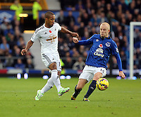 Liverpool, UK. Saturday 01 November 2014<br /> Pictured L-R: Wayne Routledge of Swansea against Steven Naismith of Everton <br /> Re: Premier League Everton v Swansea City FC at Goodison Park, Liverpool, Merseyside, UK.