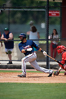 Atlanta Braves third baseman Jose Bautista (1) hits a single in the top of the ninth inning during a Minor League Extended Spring Training game against the Philadelphia Phillies on April 20, 2018 at Carpenter Complex in Clearwater, Florida.  (Mike Janes/Four Seam Images)
