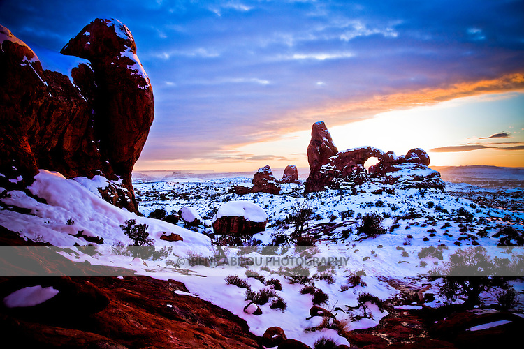 Turret Arch during a winter sunset in Arches National Park near Moab, Utah.  Over many years, the forces of erosion have created many such arches, pinnacles, and spires.