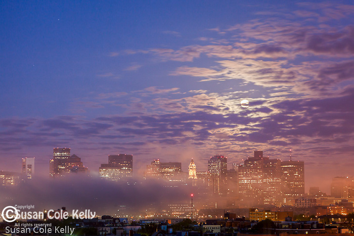 The supermoon moonset over the Boston skyline, Boston, Massachusetts, USA