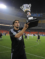 DC United defender Dejan Jakovic (5) holds the Atlantic Cup that was earned after defeating the New York Red Bulls.  DC United defeated the New York Red Bulls 2-0, at RFK Stadium ,Thursday June 4, 2009.