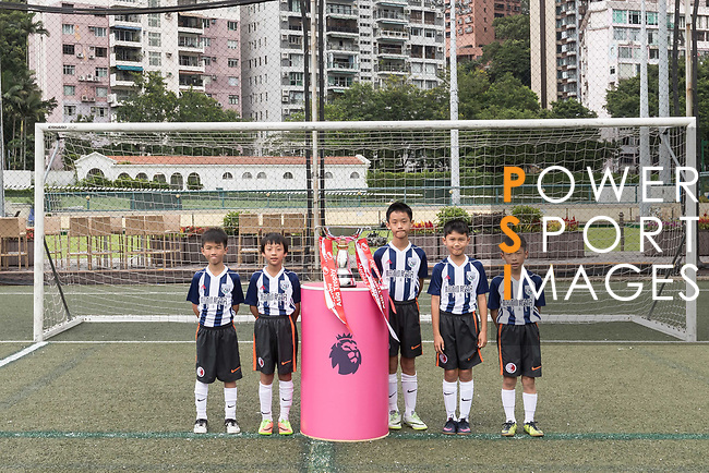 Hong Kong children pose for a group photo with the Premier League Asia Trophy in front of the Hong Kong skyline for the launch of the Premier League Asia Trophy 2017 at the Hong Kong Football Club on 01 June 2017 in Hong Kong, China. Photo by Chris Wong / Power Sport Images