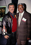 Burt Reynolds and Ossie Davis<br /> attending the N.A.T.P.E. TV Convention on January 18, 1994 in Miami, Florida.