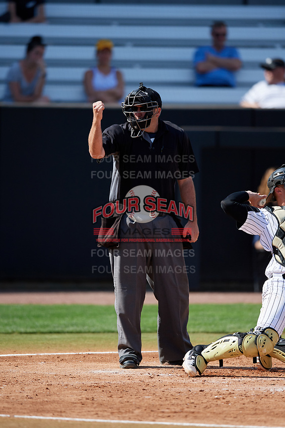 Home plate umpire John Bennett calls a strike during a game betweenn the Siena Saints and the UCF Knights on February 17, 2019 at John Euliano Park in Orlando, Florida.  UCF defeated Siena 7-1.  (Mike Janes/Four Seam Images)