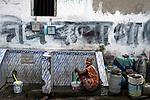 An old lady collects water from timed water supply tap at Maniktola slum in Kolkata during 21 days lock down in India due to covid 19 pandemic. Kolkata, West Bengal, India. Arindam Mukherjee.