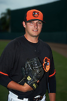 GCL Orioles pitcher Will Dennis (23) poses for a photo after the second game of a doubleheader against the GCL Rays on August 1, 2015 at the Ed Smith Stadium in Sarasota, Florida.  GCL Orioles defeated the GCL Rays 11-4.  (Mike Janes/Four Seam Images)